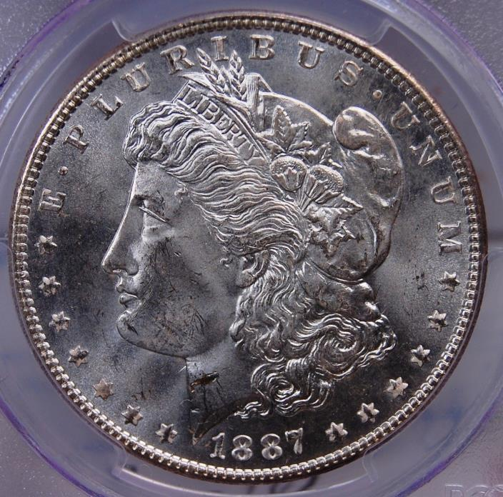 1887 MORGAN DOLLAR PCGS MS 64 SATINY SMOOTH HINT OF TONE ON THE REVERSE