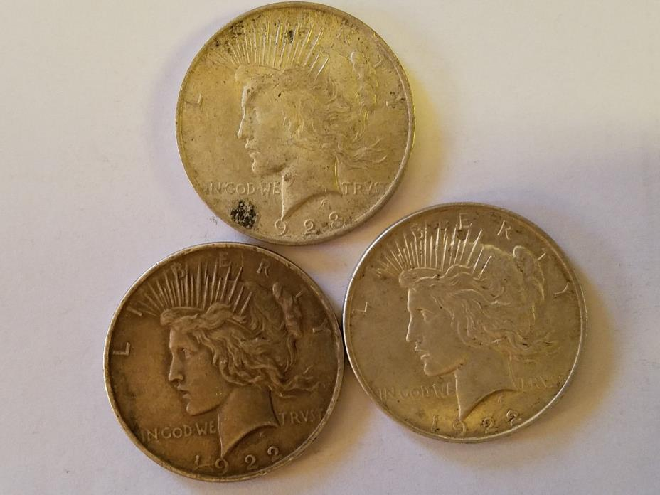 3 PEACE DOLLARS (2 1922-P AND 1 1923-P)