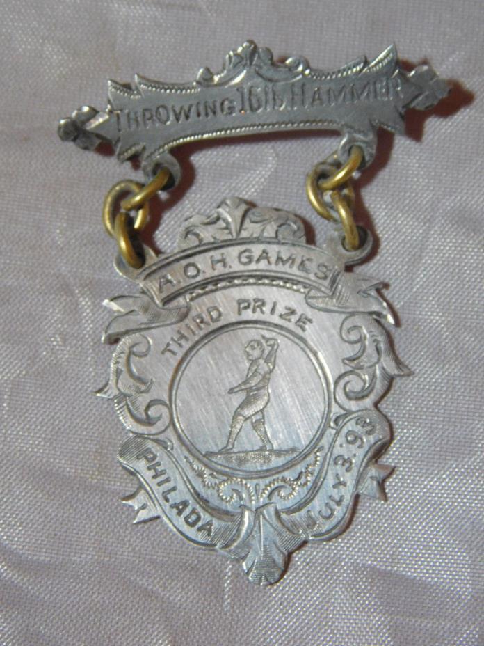 1893 SILVER A.O.H. GAMES MEDAL THROWING 16LB HAMMER ANCIENT ORDER OF HIBERNIANS