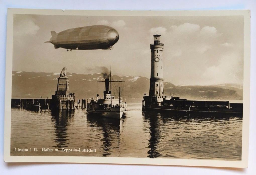 Vintage RPPC Postcard Graf Zeppelin LZ127 airship Lindau Harbor lighthouse ship