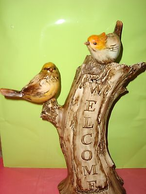 Welcome Sign with 2 Birds Welcoming You on a Tree-like Stump