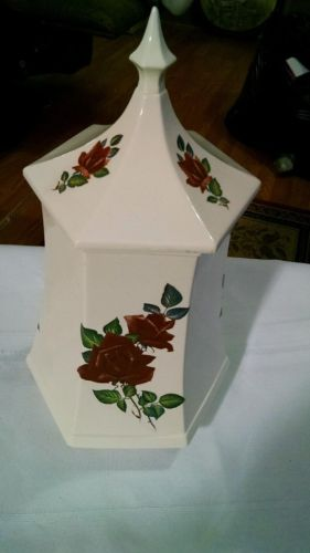 ceramic storage jar. six sided. hand painted. steeple top.