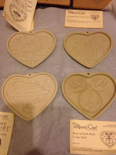 4 various Pampered Chef Clay Cookie Molds with boxes/care instructions