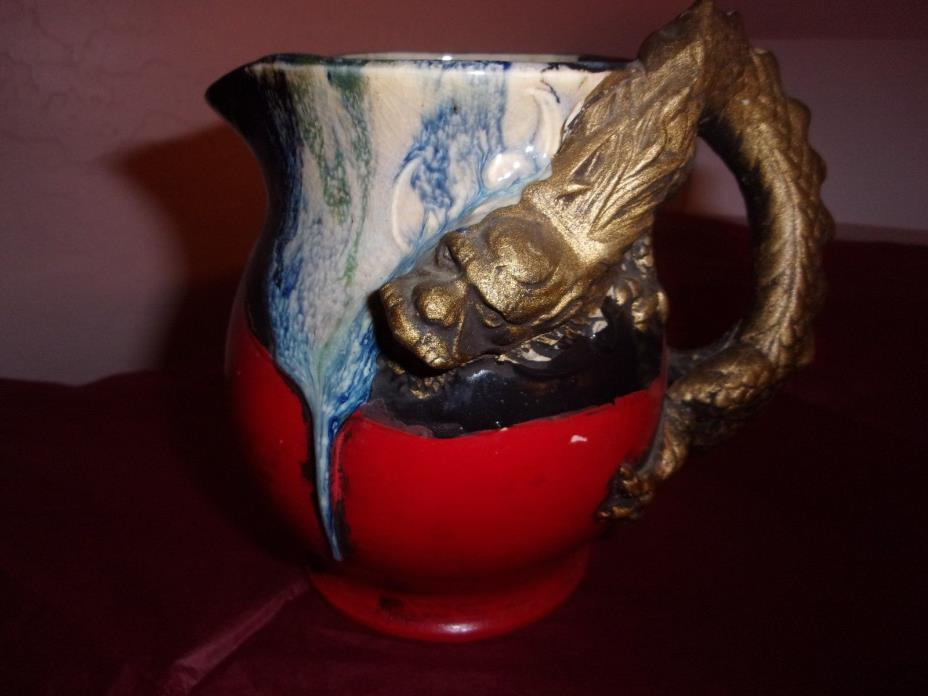 Japanese ceramic pitcher with gold dragon handle