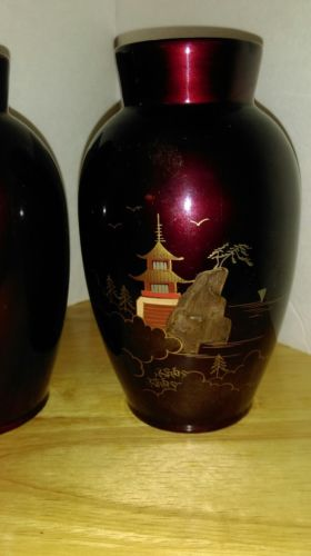 set of two small hand painted vases.
