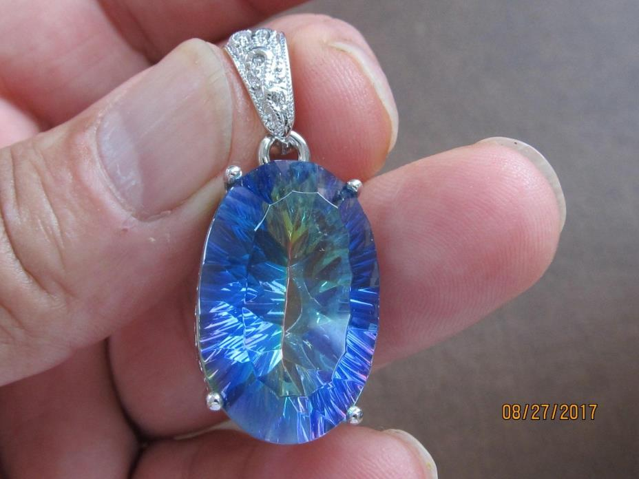 Sterling silver marked 925 pendant blue mystic topaz