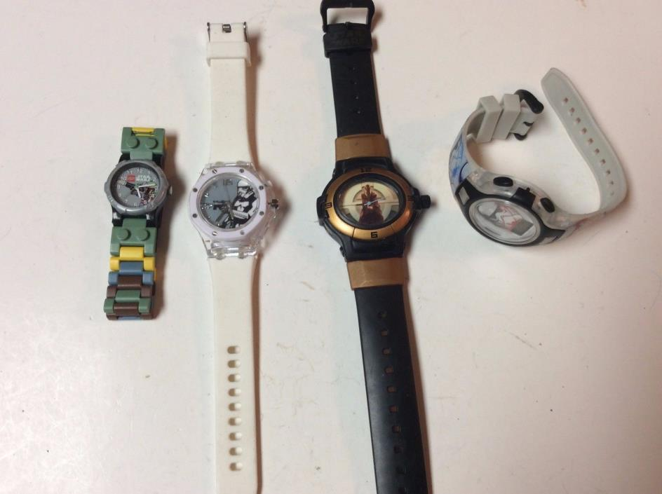 Lot of 4 Star Wars themed watches,great find in a lot,intact,sold as-is     T421