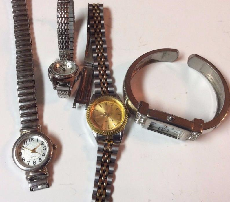 Lot of 4 womens fashion watches,sold as-is for parts and or repair          T367