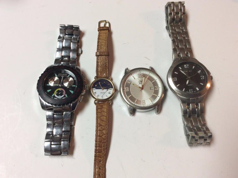Lot of 4 watches, 3 mens & 1 womens,sold as-is for parts and or repair,     T350