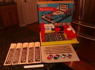 REMCO MOVIELAND DRIVE IN w/ PLATFORM, BOX, 4 CARS, 5 FILM STRIPS, BATTERY COVER