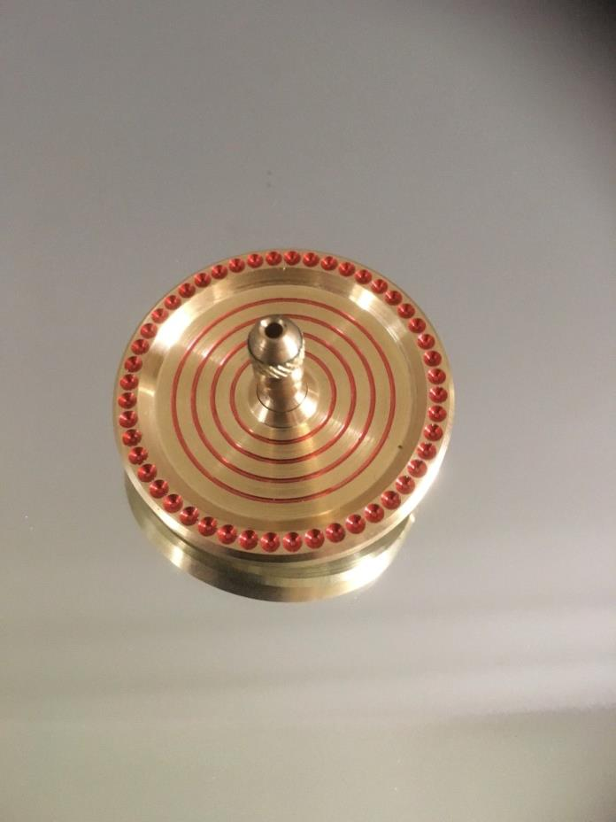 Brass spinning top with ceramic bearing, index and ring design (over 7 min spin)