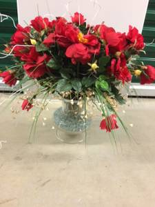 Red flower arrangement with footed glass vase (McLean)