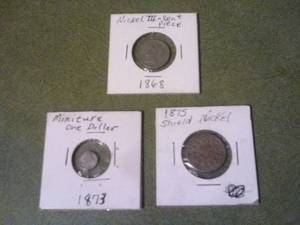 3 american coins from the 1800s (Columbus)