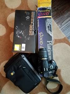 Nikon D5100 SLR with case , tripod (euless)