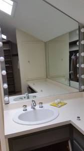 Vintage bathroom--vanity, white oval sink, 2 wall mirrors (Zionsville)