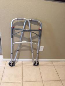 2 walkers, a tub seat, an adjustable table, a toilet safety rail (Highlands