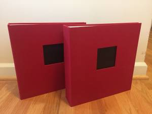 2 matching red fabric covered D-ring photo albums/binders # (Sw 87th Ave)