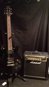 Electric guitar and amplifier (East moline)