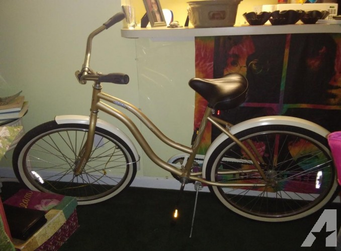Gold excellent condition beach cruiser ..huffy....gold tires great