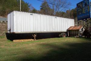 semi - trailer, triple sink, grease trap, chain saw horse (Pigeon Forge)