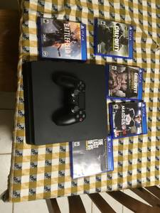 PS4 w/ 5 Games and Stand (Pascagoula)