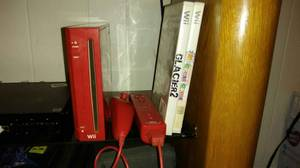 Red Wii with Wireless Sensor Bar and 2 games