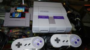 Like new Super Nintendo console system with two controllers & games (GARLAND