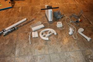 Wii console and a remote with extra batteries. (Yuma)