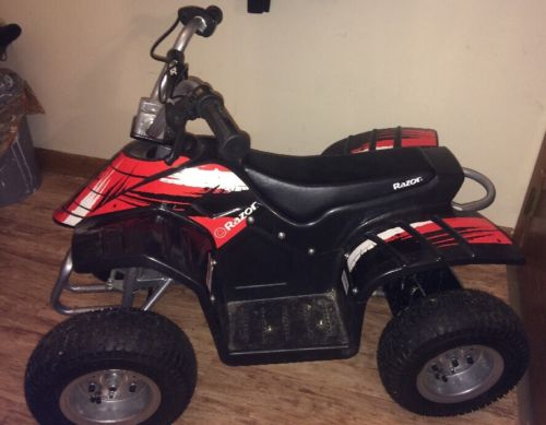 Razor Dirt Quad battery powered 4 Wheeler plus Charger *PICK UP ONLY*