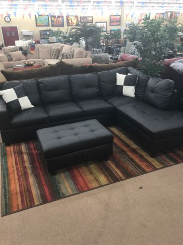 Beautiful Black Leather Sectional With Ottoman . Come With Pillows Shown As Well