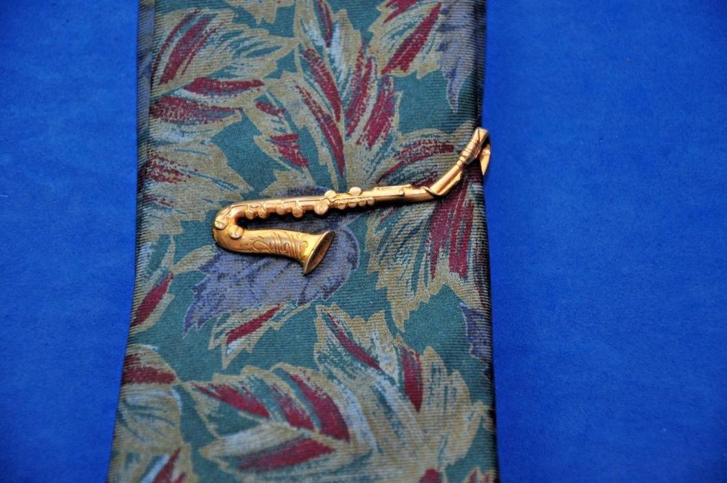 1960s SAXOPHONE TIE  bar  made by swank  gold plated  nice   vintage peice