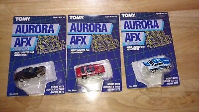 (3) TOMY AURORA AFX NIGHT LIGHTED SLOT CARS UNUSED ON UNPUNCHED CARDS NO. 8640