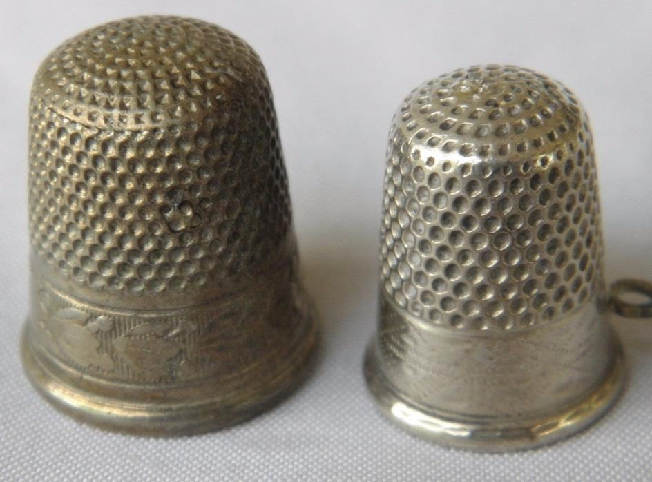 2 SILVER  VINTAGE  THIMBLES  1 STERLING .1 SILVER PLATED