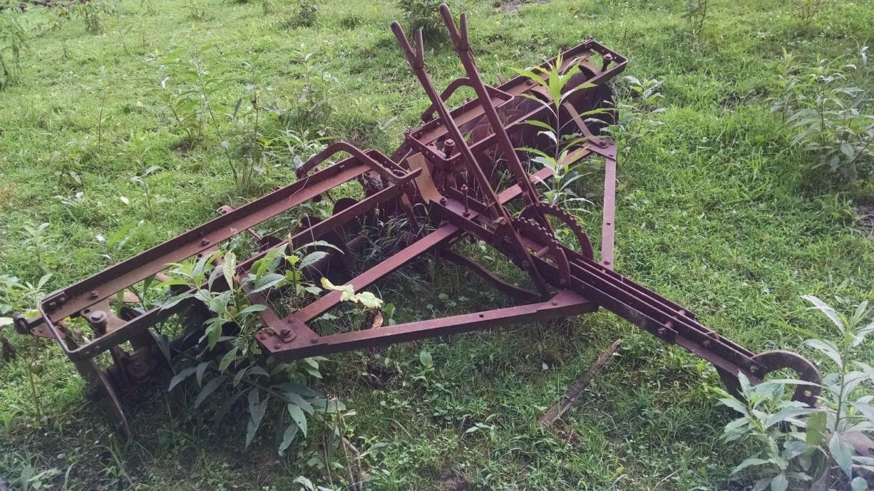 Used harrow, disk, plow, ripper drag vintage farm equipment