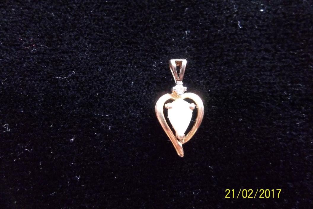 14k yellow gold heart shaped genuine opal and  diamond pendent