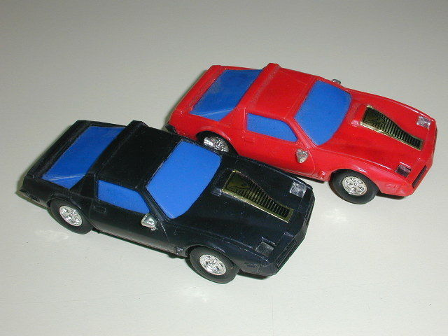 2 VINTAGE ARTIN 1/43 SCALE PONTIAC FIREBIRD TRANS AM SLOT CARS - BLACK AND RED