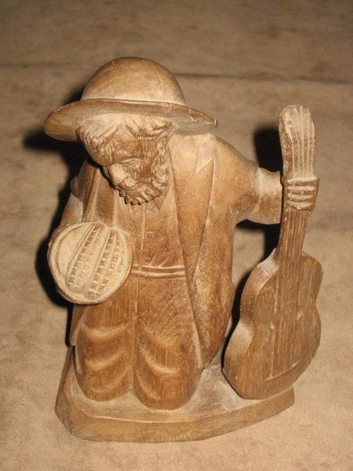 WOOD CARVING   KNEELING MAN WITH GUITAR