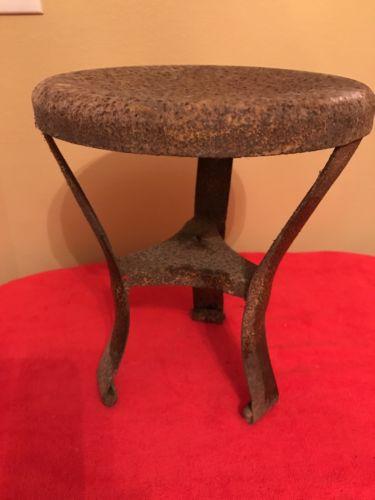 Antique metal milking stool