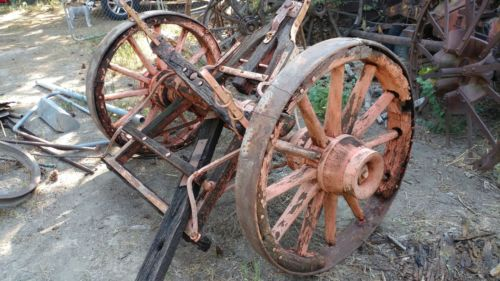 antique horse-drawn Pioneer Wagon Wheels and axle