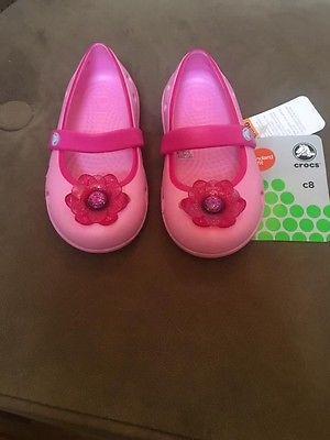 Pink flower crocs toddler size 8