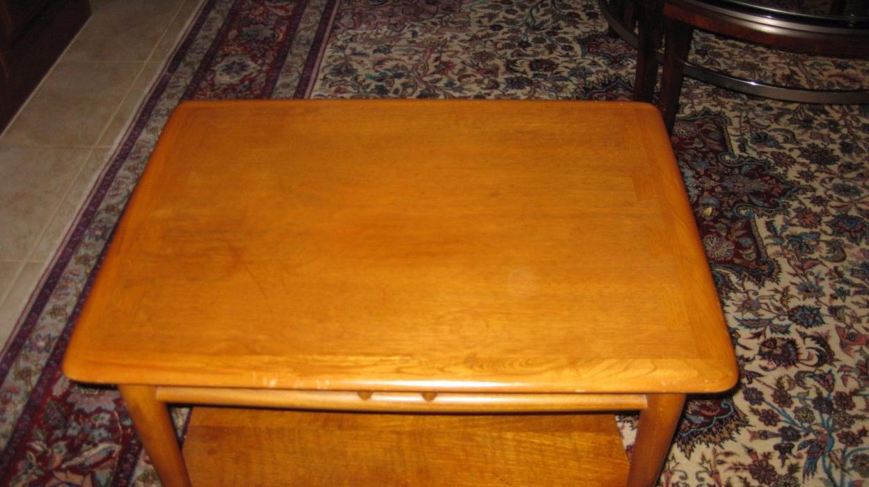 one dove tail solid wood end table