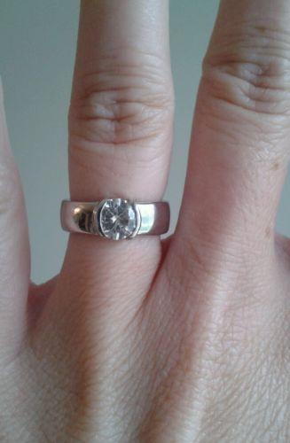 Moissanite 14kt white gold bezel ring
