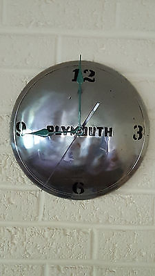 PLYMOUTH HUBCAP QUARTZ WALL CLOCK