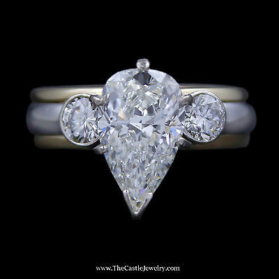 Enchanting Pear Shaped Diamond Engagement Ring w/ Bezel Set Round Diamond Sides