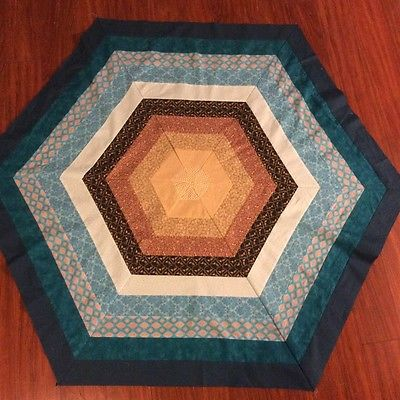 Handmade turquoise and brown hexigon lap quilt