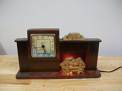 vintage fireplace electric clock for restoration or parts.