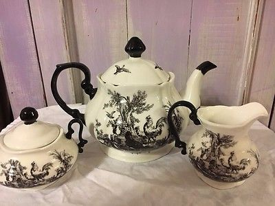 Toile teapot, sugar, creamer set