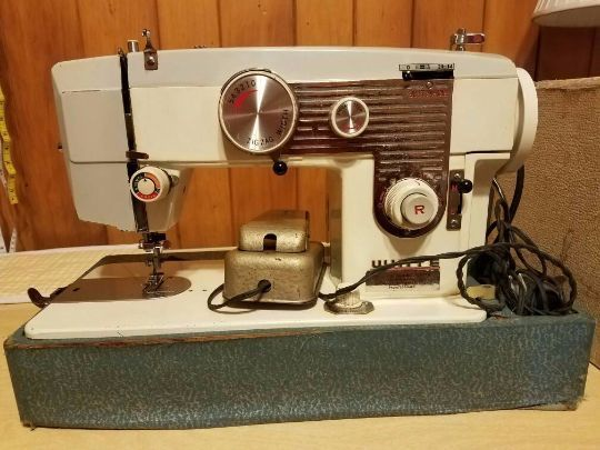 vintage white sewing machine  early 60s