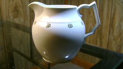 Hall China white pitcher with gold snowflakes