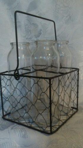 Mini glass milk bottles in metal crate